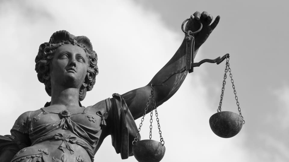 scales of justice criminal lawyer